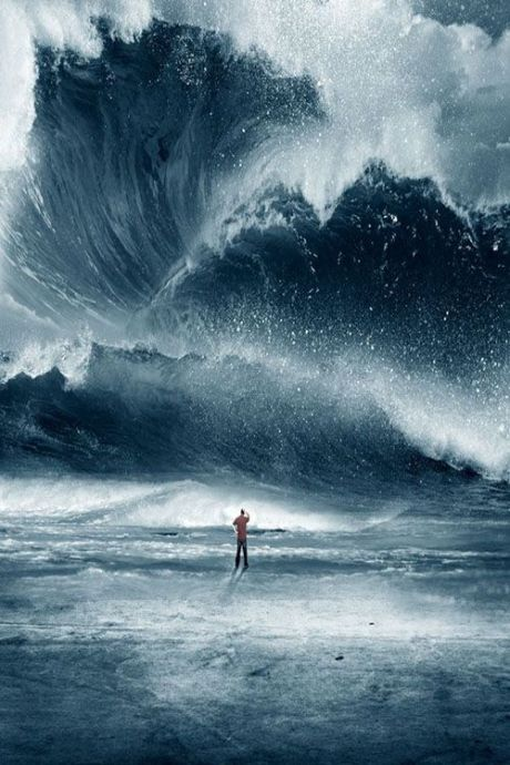 Huge Tidal wave crashing onto the beach with man